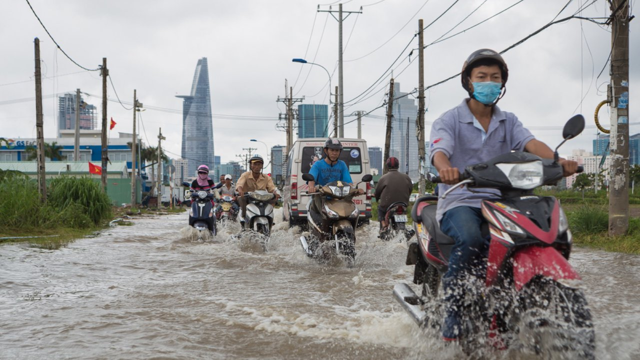 Motorbikes in a flood, Asia